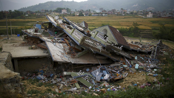 A collapsed house is pictured after the April 25 earthquake in Kathmandu.