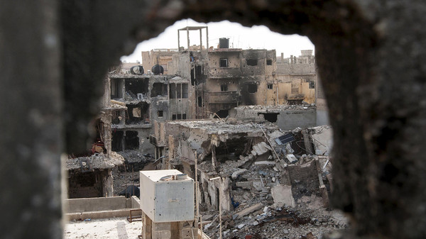 Damaged buildings are pictured after clashes between forces in Benghazi.