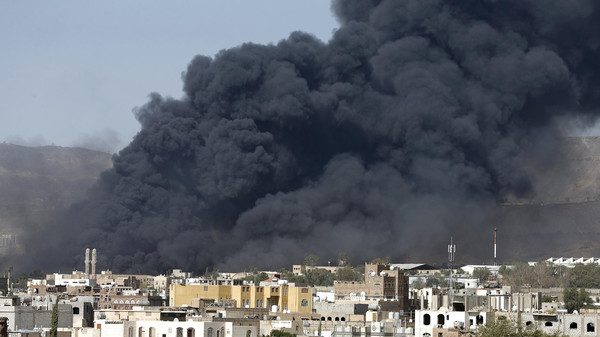 Smoke rises after air strikes hit military sites controlled by the Houthi group in Yemen's capital Sanaa May 12, 2015.