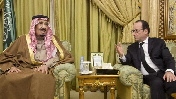 French President Francois Hollande (right) seen meeting with Saudi King Salman bin Abdul Aziz at the Diwan royal palace in Riyadh, on January 24, 2015.