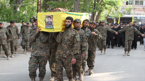 Lebanon's Hezbollah members carry the coffin of their fellow fighter Hamza Zaiter during his funeral in Baalbek, in the Bekaa valley.