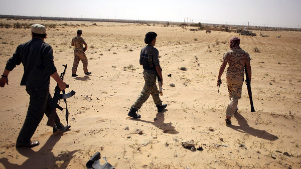 Libya Dawn fighters search for ISIS militants during a patrol near Sirte March 17, 2015.