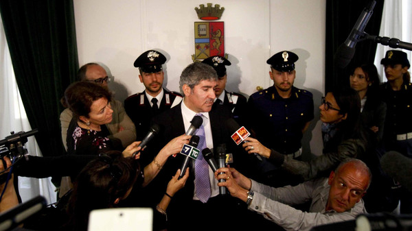 Milan chief anti-terrorism investigator Bruno Megale, center, speaks during a press conference in Milan, Italy, Wednesday, May 20, 2015.