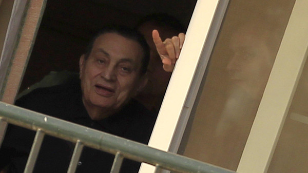 Ousted Egyptian president Hosni Mubarak waves to his supporters outside the area where he is hospitalized during his birthday at Maadi military hospital on the outskirts of Cairo May 4, 2015.