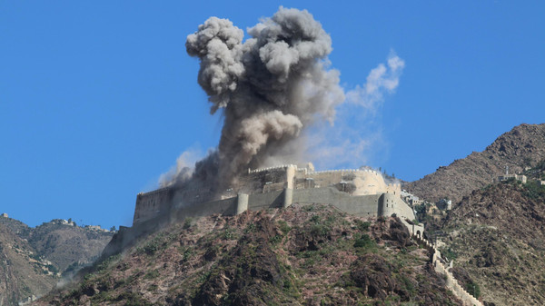Smoke rises from Al-Qahira castle, an ancient fortress that was recently taken over by Houthis, following a Saudi-led airstrike in Taez city, Yemen, Tuesday, May 12, 2015.