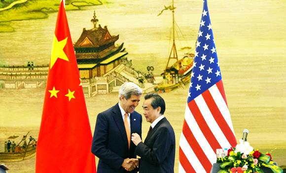 US Secretary of State John Kerry, left, and Chinese Foreign Minister Wang Yi shake hands after a news conference following meetings at the Ministry of Foreign Affairs in Beijing, China on Saturday.