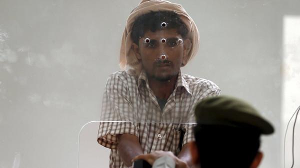 Yemeni man entering Saudi Arabia waits to stamp his passport in Jazan on Saudi's border with Yemen.