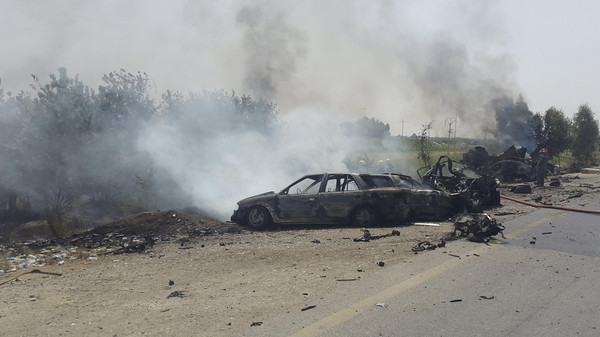 Smoke rises from the site of a car bomb attack on the outskirt of Diyala province May 24, 2015.