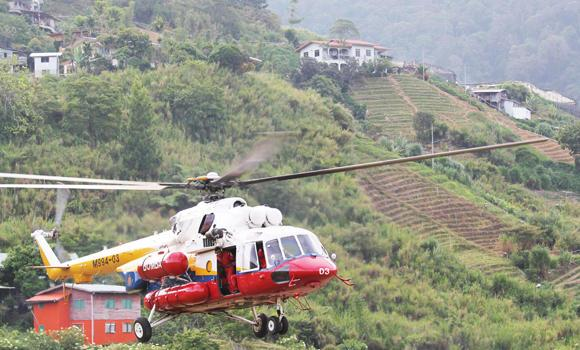 A helicopter leaves Kundasang, Malaysia for Mount Kinabalu to recover the bodies of climbers on Saturday.