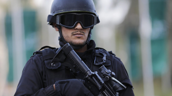 A police officer stands guard near a hotel in Manama, Bahrain, Dec. 5, 2014.
