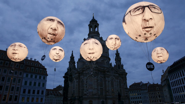 Balloons made by the 'ONE' campaigning organisation depicting leaders of the countries members of the G7 in Dresden.