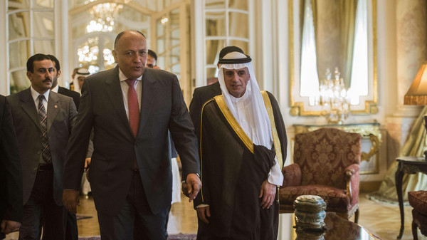 Egyptian Foreign Minister Sameh Shoukri (C-L) and his newly appointed Saudi counterpart, Adel al-Jubeir, arrive for a joint press conference following their meeting in Cairo on May 31, 2015.