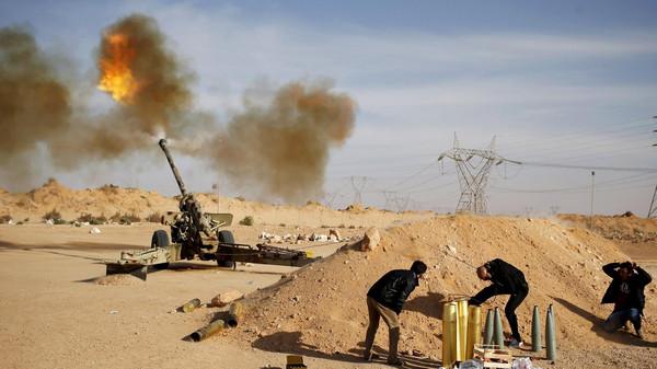 Libya Dawn fighters fire an artillery cannon at ISIS militants near Sirte March 19, 2015.