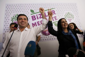 Co-chairs of the pro-Kurdish Peoples' Democratic Party (HDP), Selahattin Demirtas (L) and Figen Yuksekdag celebrate inside party's headquarters in Istanbul, Turkey, June 7, 2015.