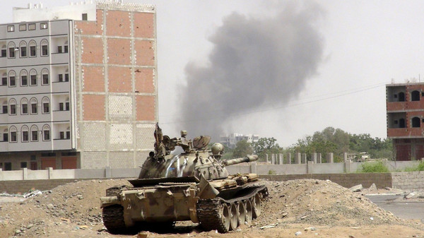 Smoke billows from the site of a Saudi-led air strike on a Houthi position in the outskirts of Yemen's southern port city of Aden.