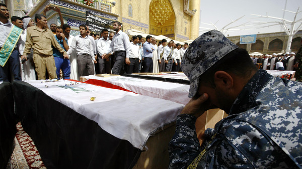 Iraqi mourners attend the funeral of members of the security forces who were killed the previous day in a suicide attack on an Iraqi police base north of Baghdad that killed at least 37 people, on June 2, 2015 in the holy Shiite city of Najaf in southern Iraq.