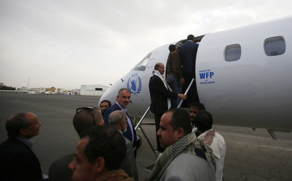 Yemeni political groups, including Shiite rebels known as Houthis, get on an airplane for Geneva for U.N.-led peace talks at the airport in Sanaa, Yemen, Sunday, June 14, 2015.