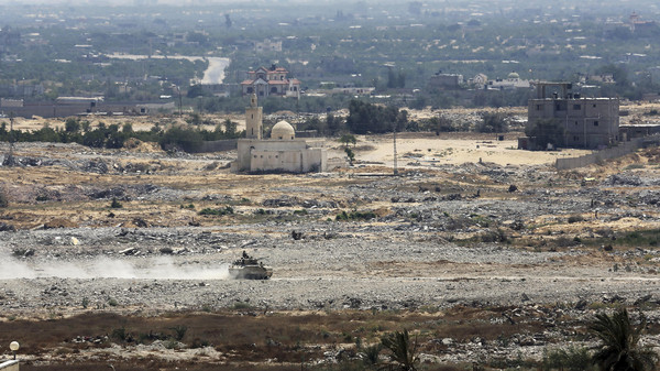 An Egyptian military tank patrols on the Egyptian side of the border, seen from the south of the Gaza Strip, Thursday, July 2, 2015.