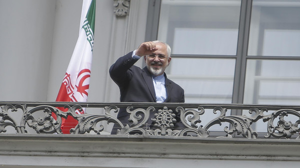 Iranian Foreign Minister Zarif stands on the balcony of Palais Coburg, the venue for nuclear talks in Vienna.