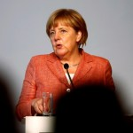 Germany's Merkel says she has not changed course on migrant policy