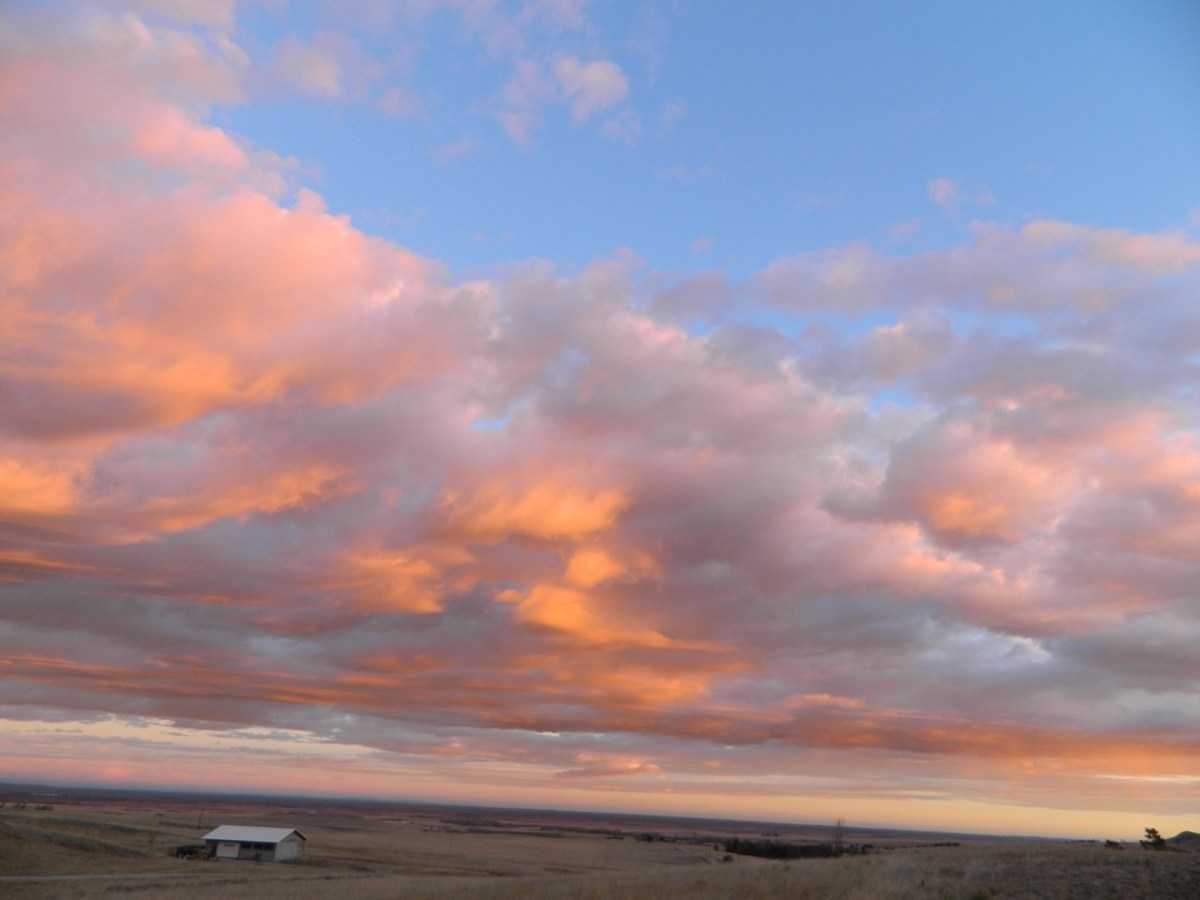Sunrise-orange painted clouds