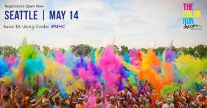 Color Run Seattle, May 14th. Use promo code RMHC (all caps) for a $5 off discount. Colorful powder wafts through the air on race participants.
