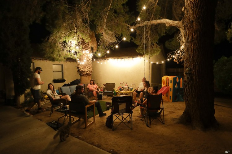 The Hope family, afraid to sleep inside, spends the night outdoors, July 6, 2019, after an earthquake in Ridgecrest, Calif. The Friday evening quake with a magnitude of about 7.1 jolted much of California.