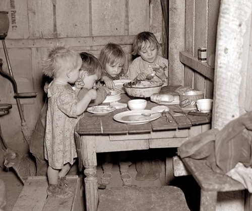 Children eating their Christmas dinner during the  Great Depression: turnips and cabbage