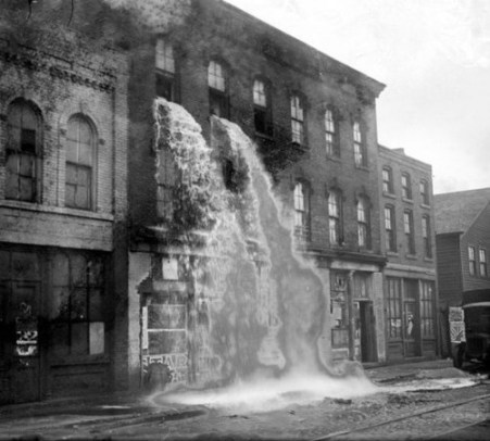 Illegal alcohol being poured out during Prohibition,  Detroit 1929