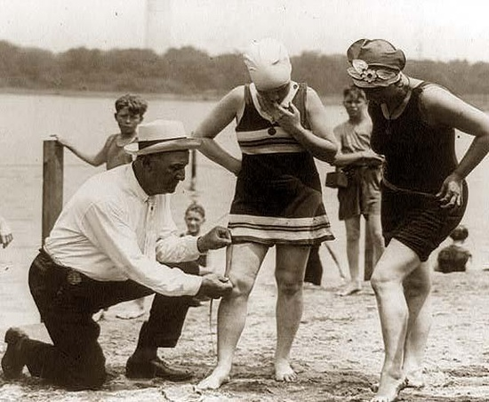 Measuring bathing suits in the early 1920s. If they  were too short, the women would be fined