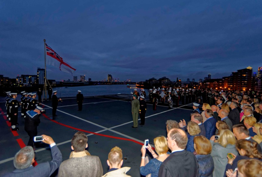 Sunset Ceremony On Board HMS Ocean anchored off the Greenwich Royal Naval College