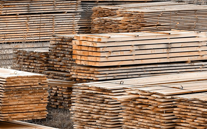 Stacked wood spruce and pine timber for construction buildings