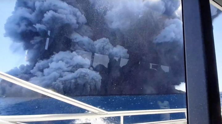 The eruption seen from the tourists' boat after they had left the island.