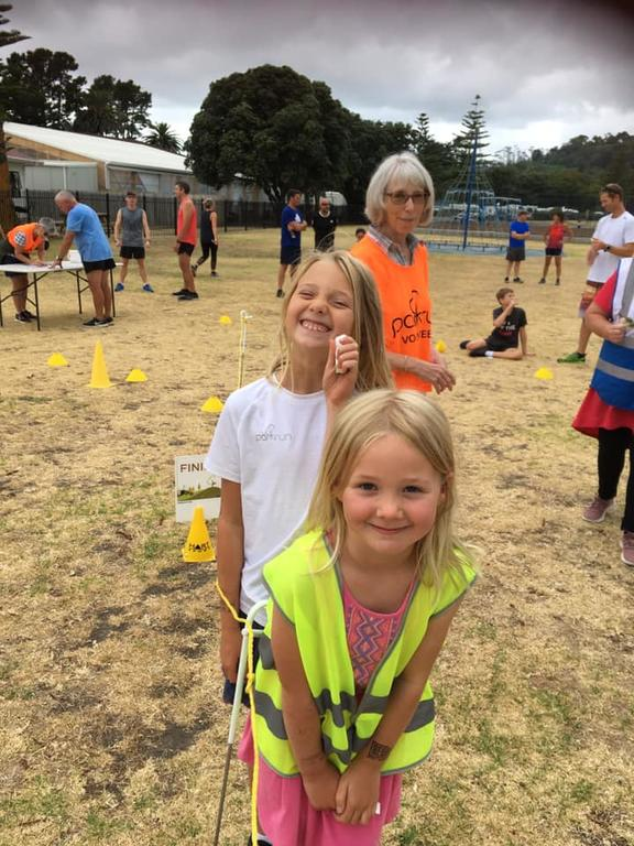 Shelagh Saprunoff (back) volunteered at Gisborne Parkrun with grandchildren Zosia (front) and Ivy Costello.