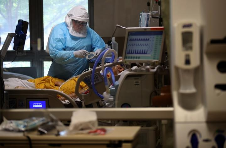 SAN JOSE, CALIFORNIA - MAY 21: (EDITORIAL USE ONLY) A nurse wears personal protective equipment (PPE) as she cares for a coronavirus COVID-19 patient in the intensive care unit (I.C.U.) at Regional Medical Center on May 21, 2020 in San Jose, California.