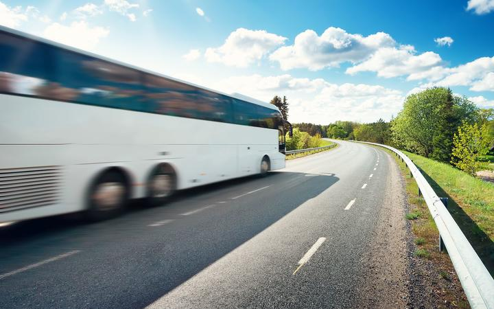 Bus on asphalt road in beautiful spring day at countryside