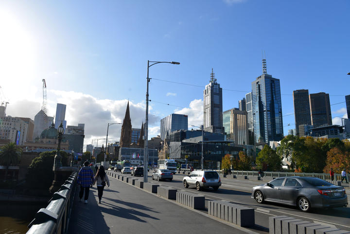 People walk at parks and streets as the city partly gets crowded after people leave their homes as Victoria begins to ease coronavirus (COVID-19) restrictions