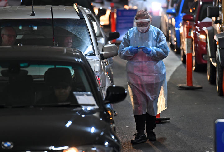 A medic at a drive-through Covid-19 testing site in a Melbourne shopping centre on 26 June, 2020.