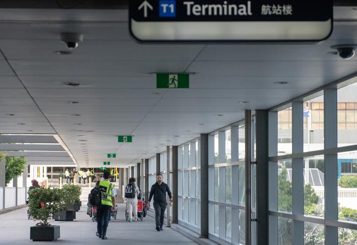 Few passengers are seen on departure at Sydney International Airport on April 11, 2020 in Sydney, Australia as the coronavirus pandemic forced the virtual shutdown of air travel.