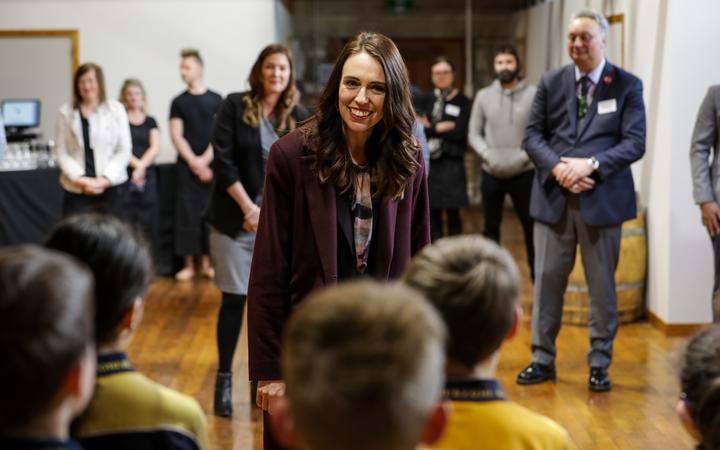 Jacinda Ardern talks to children