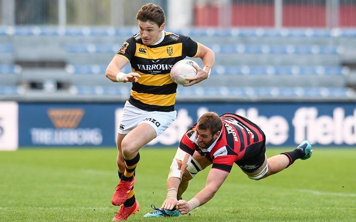 Beauden Barrett of Taranaki eludes Luke Romano of Canterbury during the Mitre10 Cup and Ranfurly Shield rugby match at Orangetheory Stadium, Christchurch, New Zealand, 19th September 2020.