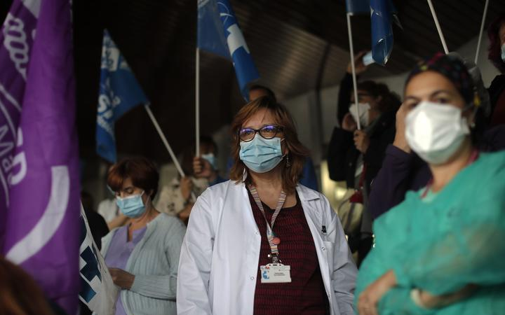 MADRID, SPAIN - OCTOBER 20: Spanish healthcare workers take part in a protest against work conditions, getting heavier due to coronavirus (COVID-19) pandemic, and privatization in the health sector in Madrid,