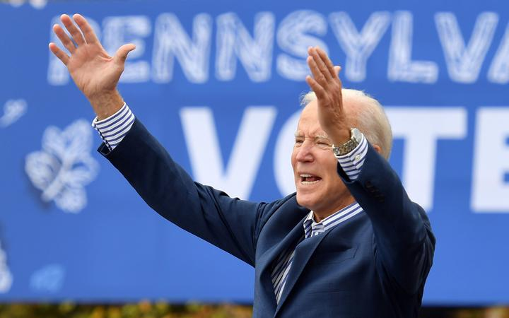 (FILES) In this file photo taken on October 24, 2020, Democratic presidential candidate Joe Biden speaks at a drive-in rally on the Bucks County Community College's Lower Bucks campus in Bristol, Pennsylvania.