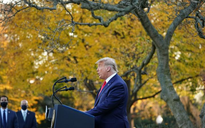 """US President Donald Trump delivers an update on """"Operation Warp Speed"""" in the Rose Garden of the White House in Washington, DC on November 13, 2020. (Photo by MANDEL NGAN / AFP)"""