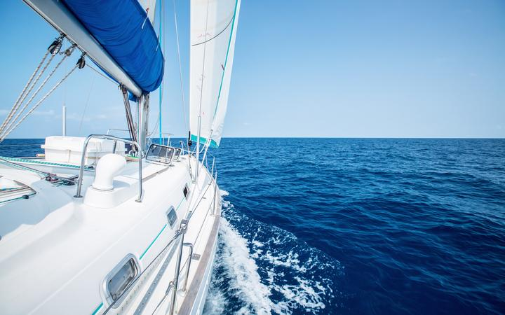Sail boat on the open sea (stock image).