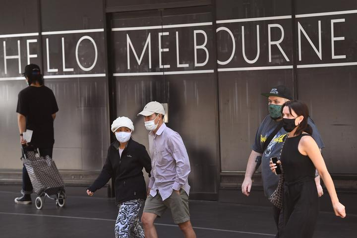 People return to Melbourne's central business district on 9 November 2020 as Australia's Victoria state government announces an easing of restrictions with no new cases of Covid-19 recorded for the tenth day in a row.