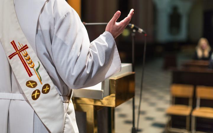 Catholic church priest during a ceremony mass