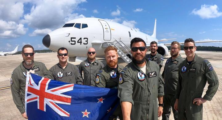 Squadron Leader Ben Smith (fourth from L) with the RNZAF Number 5 Squadron, which has been in Florida since March, training with the US Navy VP-30 Squadron.