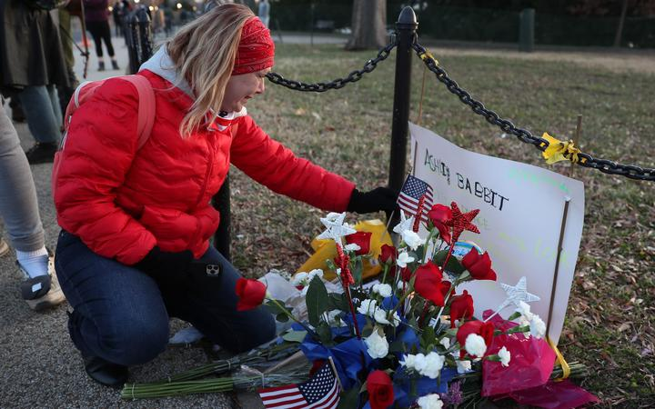 WASHINGTON, DC - JANUARY 07: Melody Black, from Minnesota, becomes emotional as she visits a memorial setup near the U.S. Capitol Building for Ashli Babbitt who was killed in the building after a pro-Trump mob broke in on January 07, 2021 in Washington, DC.