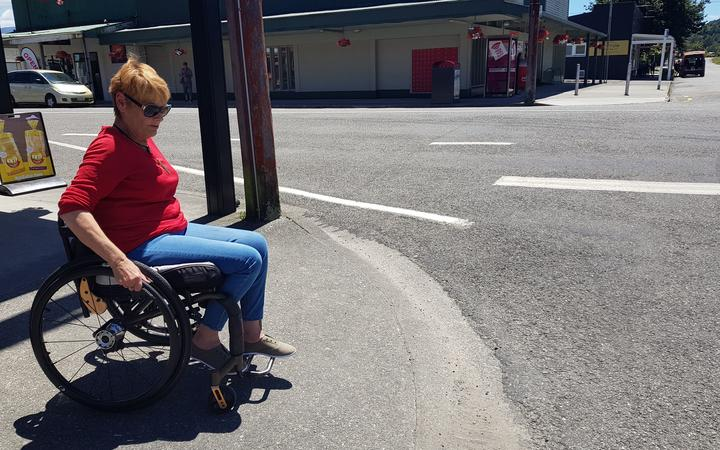 Wheelchair user Lisa Neil prepares to venture across Reefton's main drag:SH7 aka Broadway.